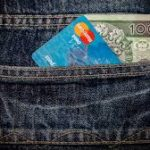 Debit card and cash in pocket